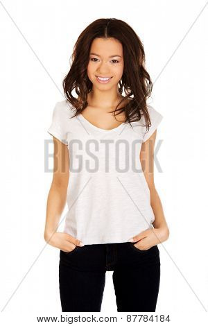 Attractive african woman with hands in pockets.