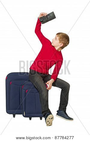 Boy Sitting On Travel Bags Looking Insight Empty Wallet