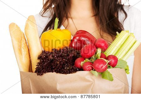 Young african woman with grocery and vegetables.
