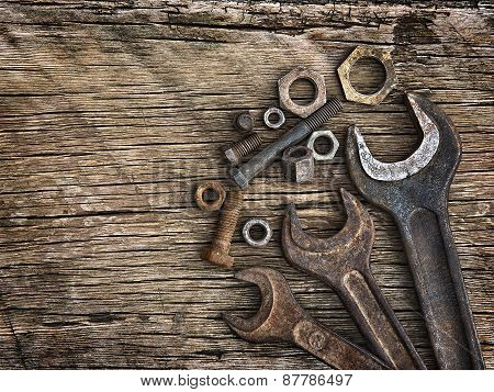 Old Wrenches On The Nuts And Bolts On A Wooden Grungy Background