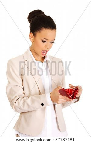 Shocked african businesswoman with wallet.