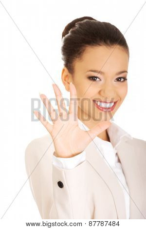 African businesswoman gesturing five in hand.