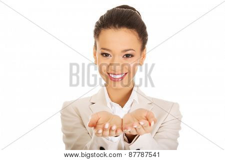 African businesswoman showing empty hands.