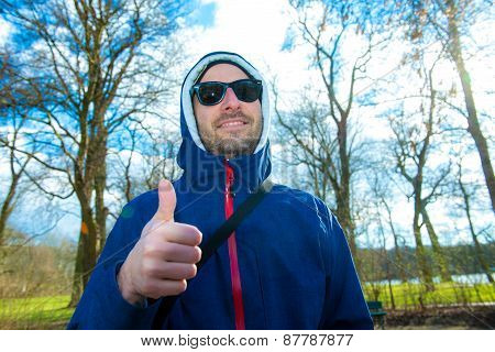 Man With Hoodie Sweater With Thumb Up