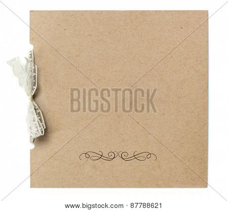 Blank invitation tied with lace ribbon, isolated on white background.  Recycled card, with beige bow.