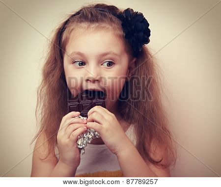 Thinking Kid With Humor Look Eating Chocolate. Vintage
