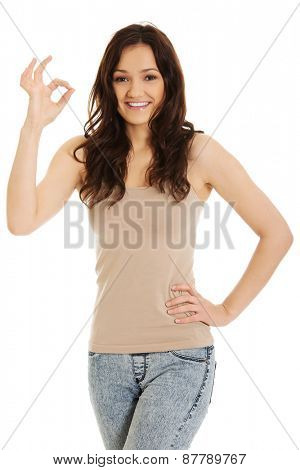 Young student woman showing perfect sign.