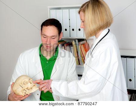 Young Doctor In Her Office With Skull