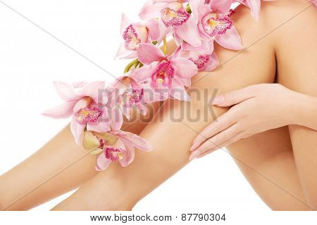 Slim long woman legs with pink flowers.