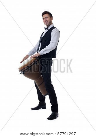 Smiling young drummer posing at camera