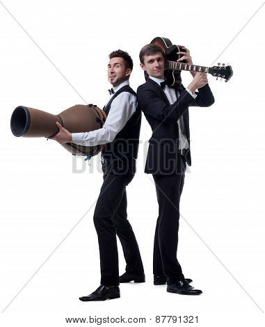 Funny guys posing with musical instruments