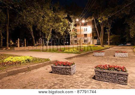 The road with flower beds in the evening