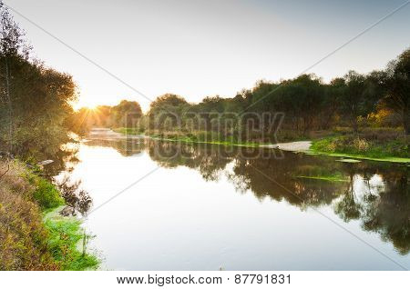 Solar dawn in summer on the river