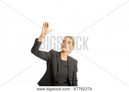 Businesswoman pressing an abstract button.