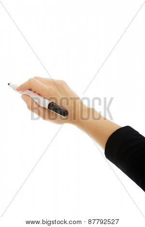 Beautiful young businesswoman writing with marker.