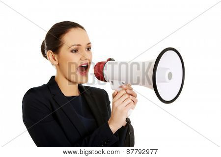 Beautiful businesswoman talking through megaphone.