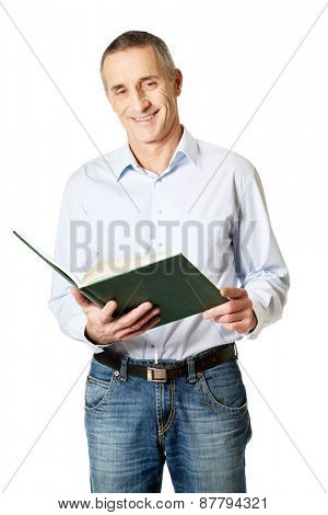 Handsome mature man reading his schedule.