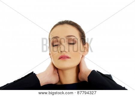Businesswoman suffering from neck pain.