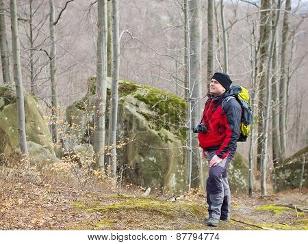 The Man With The Camera Standing In A Forest.