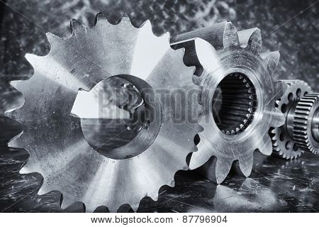 aerospace titanium cogwheels and engineering parts against aluminum