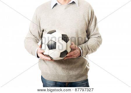 Mature man with a soccer ball.