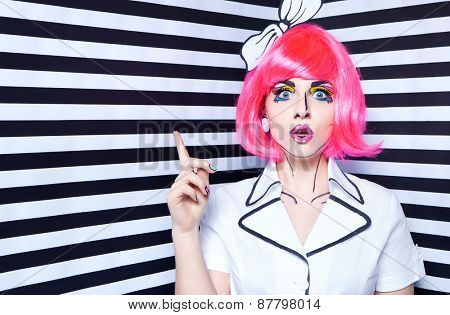 Photo of surprised young woman on stripy background with professional comic pop art make up and accessories