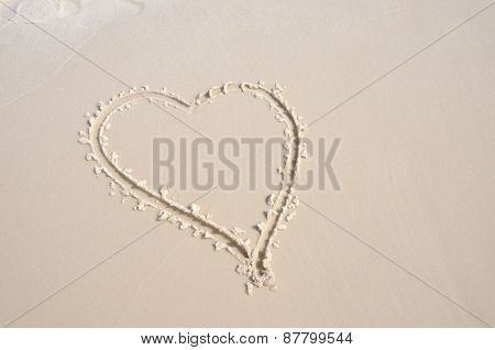 Heart shaped in soft white sand