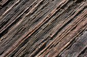 foto of shale  - General view of the relief texture of shale rock with diagonal stripes - JPG