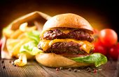 stock photo of french fries  - Hamburger with fries on wooden table - JPG