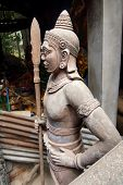 stock photo of guardian  - Guardian warrior at foot of stairway to the sleeping Buddha Phnom Kulen Cambodia - JPG