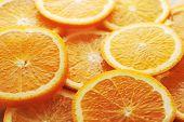 image of valencia-orange  - background made of few sliced juicy oranges - JPG