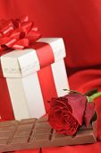 pic of rose close up  - beautiful red rose gift and chocolate on red close up - JPG