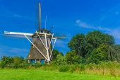 picture of windmills  - Picturesque rural landscape with windmill in Amsterdam - JPG