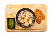 picture of condiment  - Russian ukha with salmon and codfish on a wooden plate served with sour vodka green condiment and whole grain bread - JPG