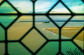 picture of michel  - A view through a window at the famous Mont St Michel abbey in France - JPG