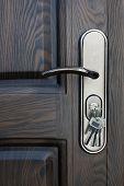 stock photo of door  - Door lock with keys on wooden door - JPG