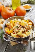 stock photo of stew  - Chicken stew with pumpkin potatoes and spices on the table - JPG