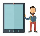 foto of beside  - A Caucasian with beard standing while holding besides a big screen tablet - JPG
