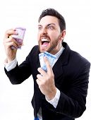 foto of brazilian money  - Happy young man holding Brazilian Money - JPG