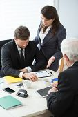 picture of assemblage  - Young businesswoman disputing with her employee - JPG