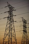 picture of power transmission lines  - Electrical transmission power supply lines at dusk - JPG