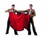 stock photo of bullfighting  - Image of funny men posing dressed as bullfighters - JPG