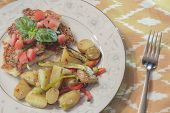 foto of crust  - Healthy yet filling parmesan crusted chicken breast topped with diced tomato and fresh basil and a side of scrumptious fingerling potaoes - JPG