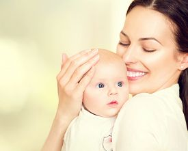 stock photo of hand kiss  - Mother and her Newborn Baby - JPG