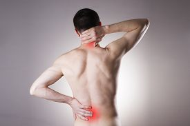 image of red back  - Pain in the back and neck in men on gray background - JPG