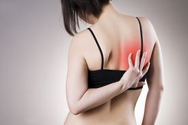 image of shoulder-blade  - Pain in back of women on gray background - JPG