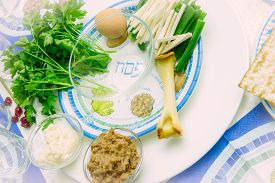 stock photo of seder  - seder plate for passover ceremony with symbols parsley egg and matzoh - JPG