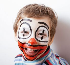 picture of pantomime  - little cute real boy with facepaint like clown - JPG