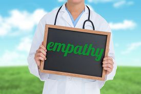 image of empathy  - The word empathy and doctor showing little blackboard against field and sky - JPG