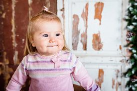 image of big lips  - Cute blond little girl with big grey eyes and plump cheeks with pursed lips - JPG